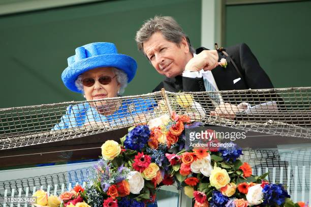 Queen Elizabeth II watches the action in the Investec Derby Stakes at Epsom Racecourse on June 01, 2019 in Epsom, England.