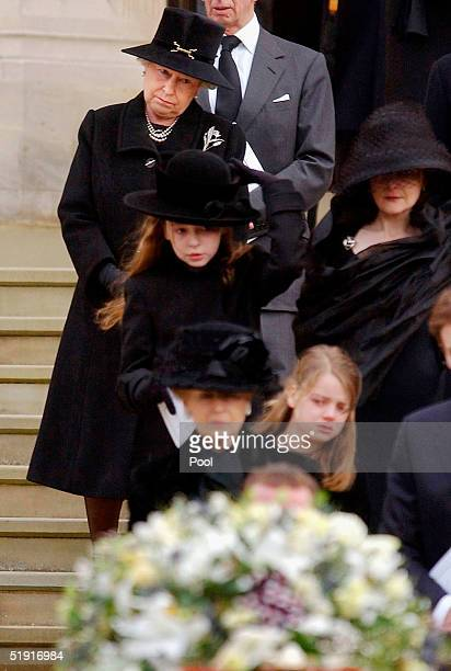 Queen Elizabeth II watches the coffinl of Sir Angus Ogilvy as it leaves his funeral held in St Georges Chapel of Winmdsor Castle on January 5 2005 in...