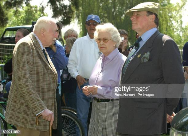 Queen Elizabeth II watches the Duke of Edinburgh competing with the Queen's Fell pony team in the Land Rover International Driving Grand Prix at the...