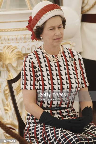 Queen Elizabeth II watches the entertainments aboard the Royal Yacht 'Britannia' upon her arrival in Fiji during her royal tour 16th February 1977