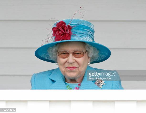 HM Queen Elizabeth II watches the final of the Harcourt Developments Queen's Cup polo tournament from the balcony of the Royal Box at Guards Polo...
