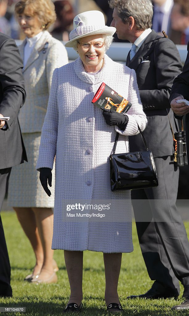 Queen Elizabeth II watches the horses in the parade ring as she attends the New to Racing Day at Newbury Racecourse on April 20, 2013 in Newbury, England.
