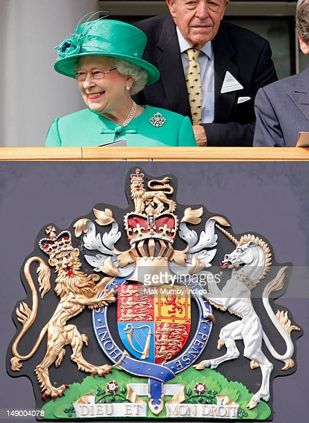 Queen Elizabeth II watches the horses parade before the King George VI and Queen Elizabeth Stakes as she attends the King George Day racing meet at...