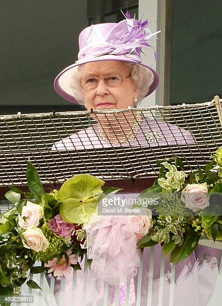 Queen Elizabeth II watches The Investec Derby during Derby Day at the Investec Derby Festival at Epsom Downs Racecourse on June 6 2014 in Epsom...
