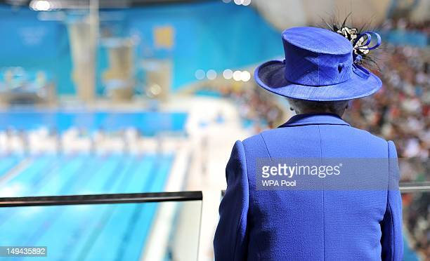 Queen Elizabeth II watches the morning session of the swimming at the Aquatics Centre during a tour of the Olympic Park on day one of the London 2012...