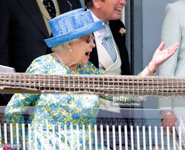 Queen Elizabeth II watches the racing as she attends 'Derby Day' of the Investec Derby Festival at Epsom Racecourse on June 1, 2019 in Epsom, England.