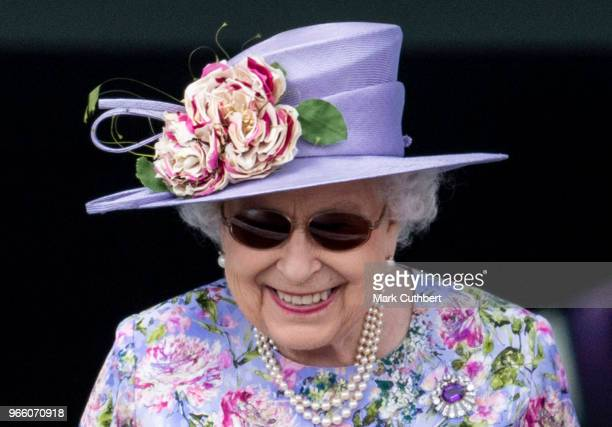 Queen Elizabeth II watches the racing at the Epsom Derby Festival at Epsom Racecourse on June 2 2018 in Epsom England