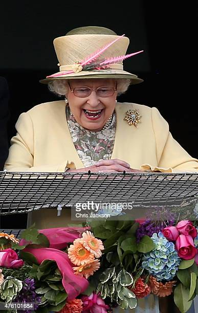Queen Elizabeth II watches the racing from the Royal Box at the Investec Derby festival at Epsom Racecourse on June 6, 2015 in Epsom, England.