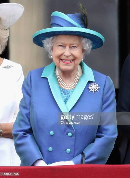 Queen Elizabeth II watches the RAF flypast on the balcony of Buckingham Palace as members of the Royal Family attend events to mark the centenary of...