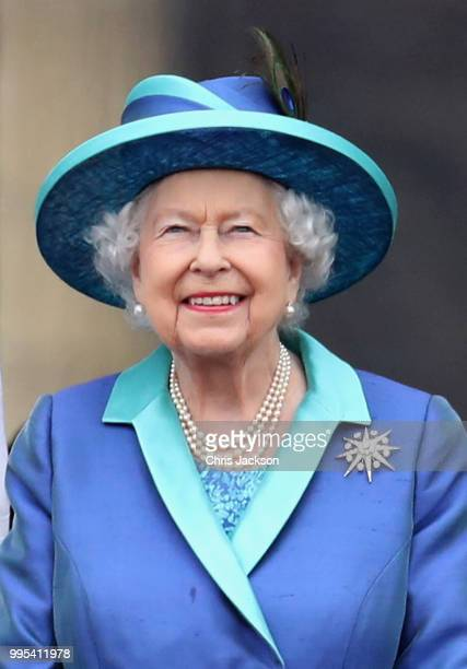 Queen Elizabeth II watches the RAF flypast on the balcony of Buckingham Palace, as members of the Royal Family attend events to mark the centenary of...