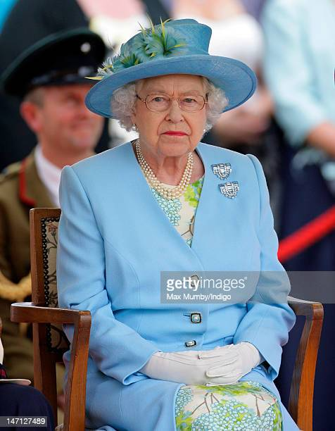 Queen Elizabeth II watches the Three Counties Diamond Jubilee River Pageant at Henley Business School during a visit to Henley-on-Thames as part of...