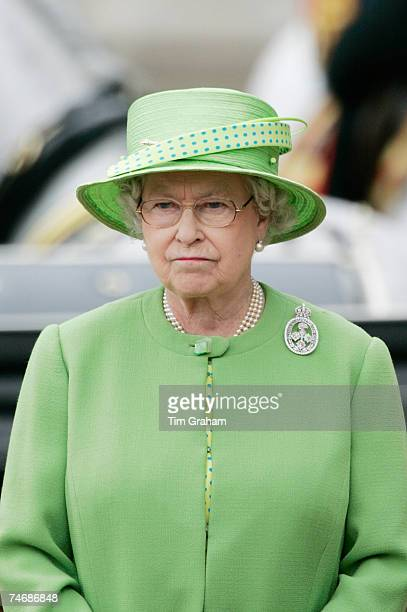 Queen Elizabeth II watches the troops in the carriage procession during the Trooping The Colour ceremony on June 16 2007 in London England