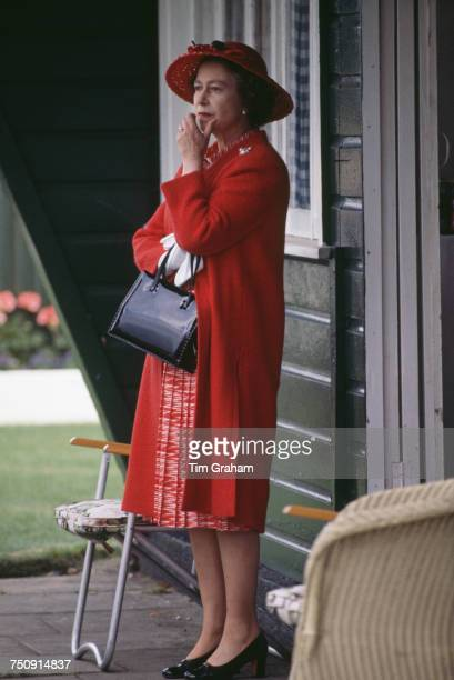 Queen Elizabeth II watching a polo match at Windsor after a day at the Ascot races 17th June 1980