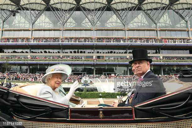 Queen Elizabeth II waves as she arrives on Ladies Day on day three of Royal Ascot at Ascot Racecourse on June 20 2019 in Ascot England