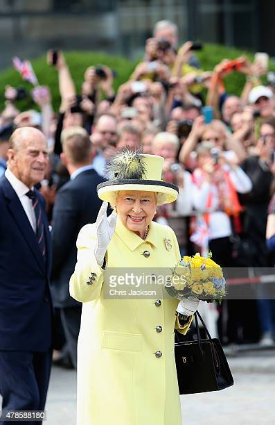 Queen Elizabeth II waves as she departs the Adlon Hotel on the final day of a four day State Visit to Germany on June 26, 2015 in Berlin, Germany.