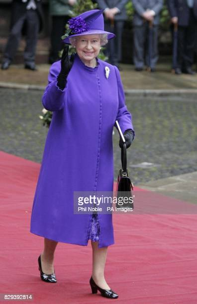 Queen Elizabeth II waves as she leaves the wedding of Lady Tamara Grosvenor to Edward van Cutsem at Chester Cathedral Prince William acted as usher...