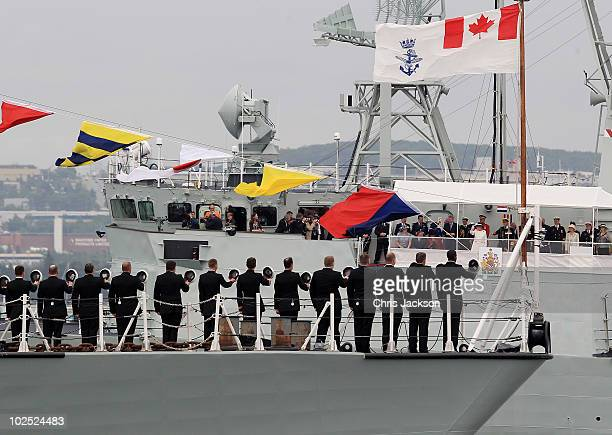 Queen Elizabeth II waves as she takes a salute from HMCS St John's for the International Fleet Review on June 29 2010 in Halifax Canada The Queen and...