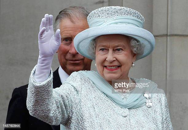 Queen Elizabeth II waves from the balcony of Buckingham Palace as Prince Charles Prince of Wales looks on during the finale of the Queen's Diamond...