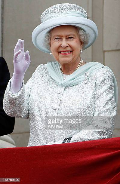 Queen Elizabeth II waves from the balcony of Buckingham Palace during the finale of the Queen's Diamond Jubilee celebrations on June 5 2012 in London...
