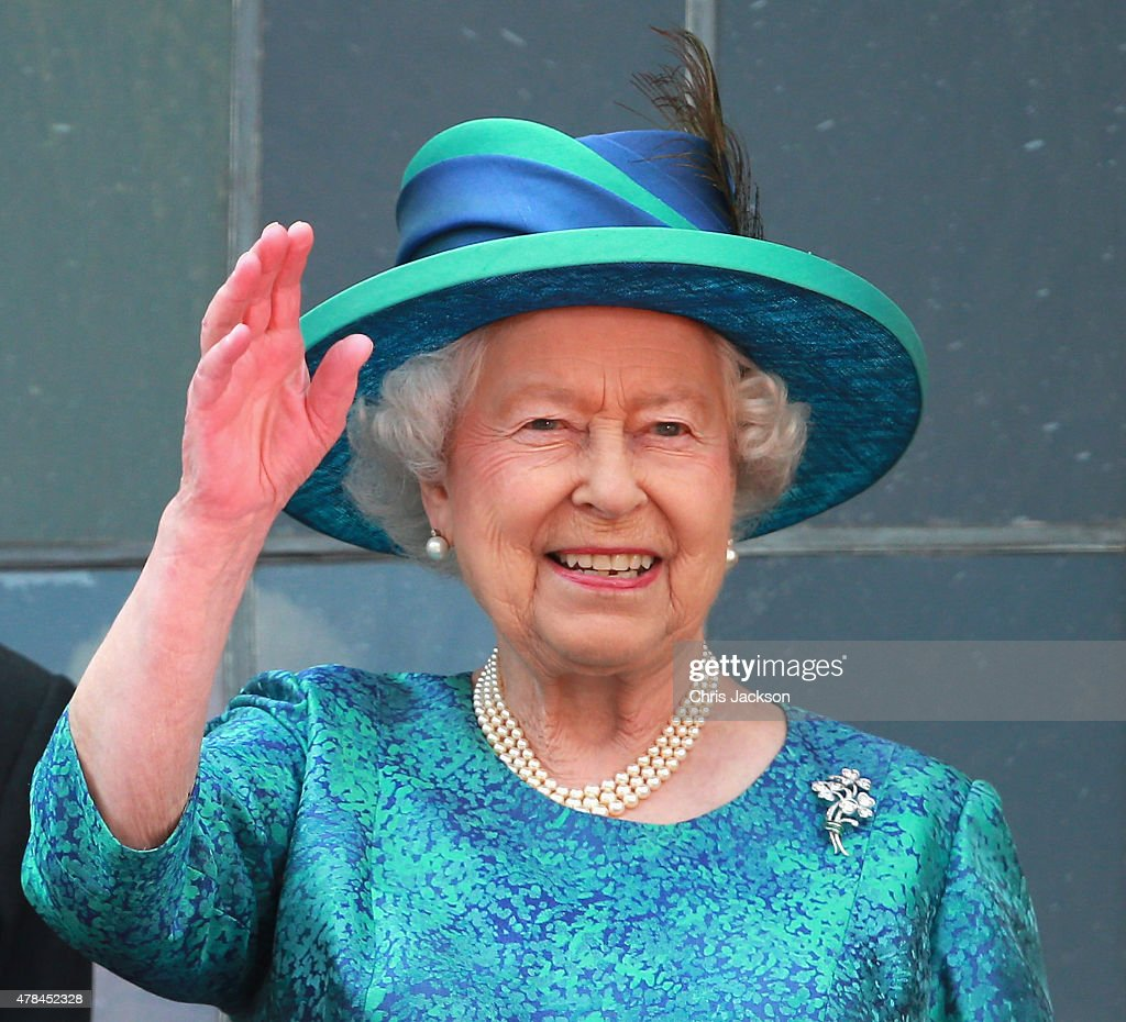 Queen Elizabeth II waves from the balcony of the city hall on June 25, 2015 in Frankfurt am Main, Germany. The Queen and Prince Philip have travelled to Frankfurt following a visit to Berlin. The Royal couple will also visit the concentration camp memorial at Bergen-Belsen during their trip, which is their first to Germany since 2004.