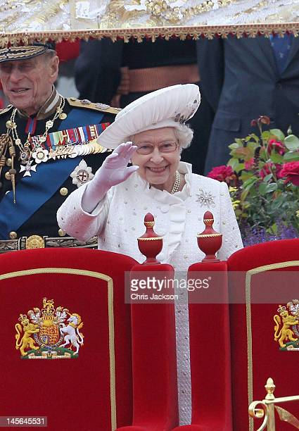 Queen Elizabeth II waves from the royal barge 'The Spirit of Chartwell' during the Diamond Jubilee Thames River Pageant on June 3 2012 in London...