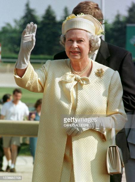 Queen Elizabeth II waves goodbye to the crowd at Woodbine Raceway in Toronto after attending the Queen's Plate Race 29 June. The Queen is on the...