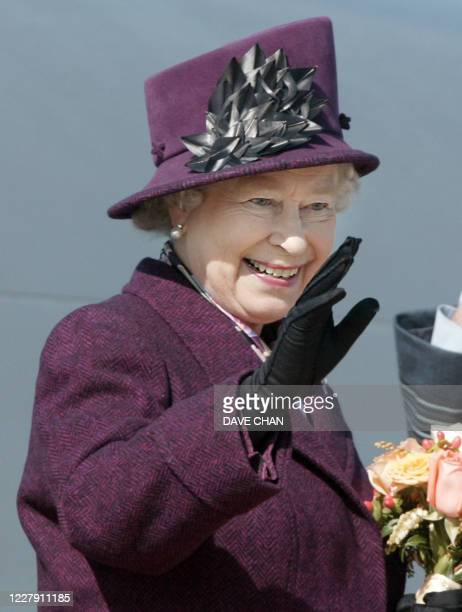 Queen Elizabeth II waves good-bye to well wishers before her flight home to England 15 October 2002 at Ottawa Airport in Ottawa, Canada. The Queen...
