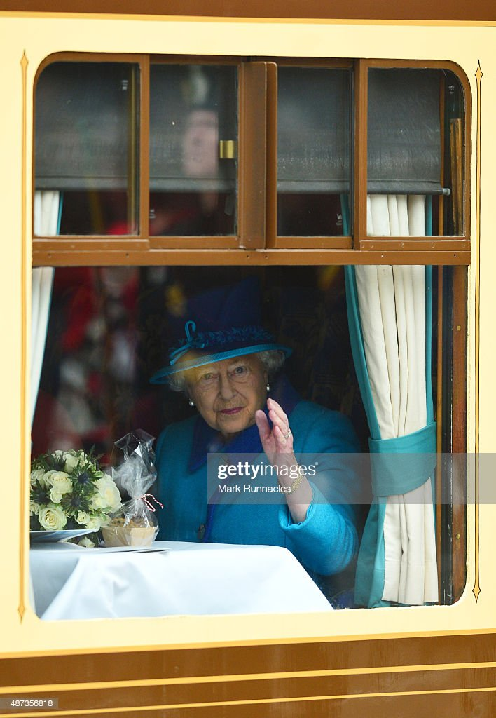 Queen Elizabeth II waves to crowds at Waverley Station from the window of the steam locomotive 'Union of South Africa' on September 9, 2015 in Edinburgh, Scotland. Today, Her Majesty Queen Elizabeth II becomes the longest reigning monarch in British history overtaking her great-great grandmother Queen VictoriaÕs record by one day. The Queen has reigned for a total of 63 years and 217 days. Accompanied by her husband The Duke of Edinburgh, she has today opened the new Scottish BorderÕs Railway.