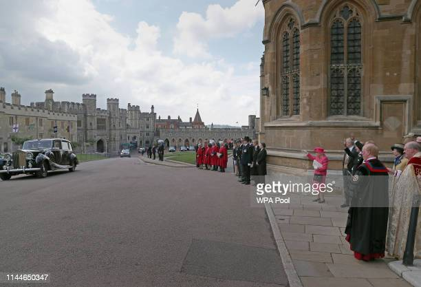 Queen Elizabeth II waves to Lady Gabriella Windsor and Thomas Kingston after their wedding at St George's Chapel, Windsor Castle on May 18, 2019 in...