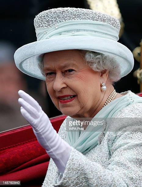 Queen Elizabeth II waves to spectators as she leaves Westminster Hall during the Diamond Jubilee celebrations on June 5 2012 in London England For...