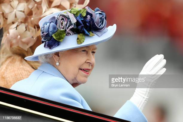 Queen Elizabeth II waves to the crowds as she arrives on day one of Royal Ascot at Ascot Racecourse on June 18, 2019 in Ascot, England.
