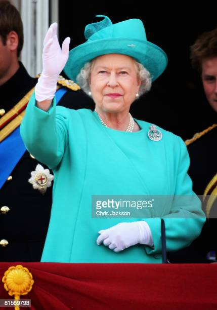 Queen Elizabeth II waves to the crowds from the balcony on Buckingham Palace during the Trooping of the Colour outside Buckingham Palace on June 14...