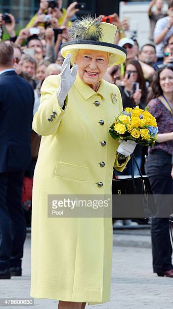 Queen Elizabeth II waves to well wishers after a short walkabout on the Pariser Platz close to the Brandenburg Gate on the final day of a four day...