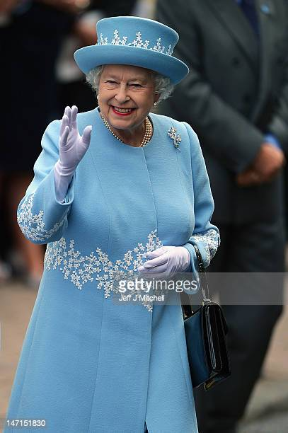 Queen Elizabeth II waves to wellwishers as she and Prince Philip Duke of Edinburgh visit Macartin's Cathedral on June 26 2012 in Enniskillen Northern...