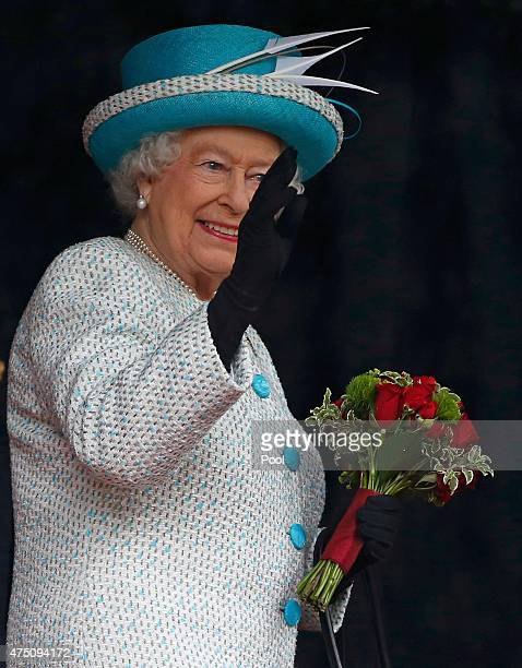 Queen Elizabeth II waves to wellwishers as she visits Lancaster Castle on May 29 2015 in Lancaster England