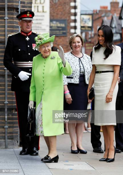 Queen Elizabeth II waves with Meghan Duchess of Sussex as she arrives for their visit to the Storyhouse on June 14 2018 in Chester England Meghan...