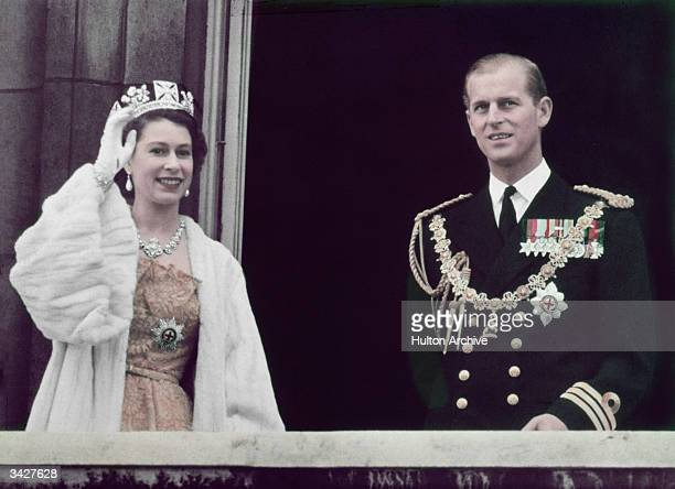 Queen Elizabeth II waving from the balcony at Buckingham Palace with her husband Prince Philip Duke of Edinburgh