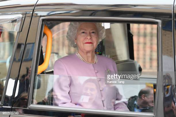 Queen Elizabeth II waxwork arrives in a black cab outside the Lindo Wing at St Mary's Hospital following the announcement that Catherine Duchess of...