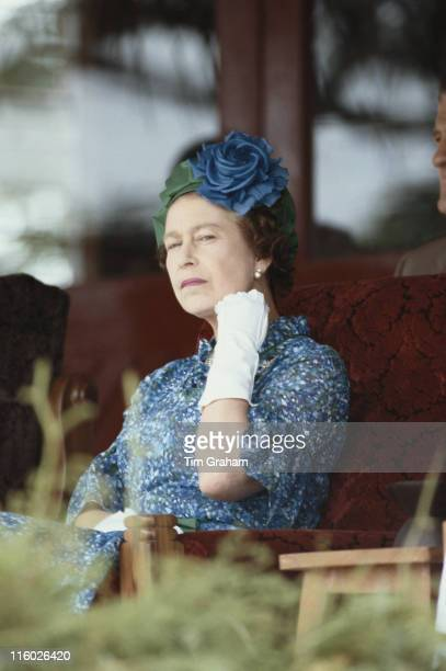Queen Elizabeth II wearing a blue dress a blue and green hat and white gloves during a visit to the island of Bau near Suva Fiji 30 October 1982 The...