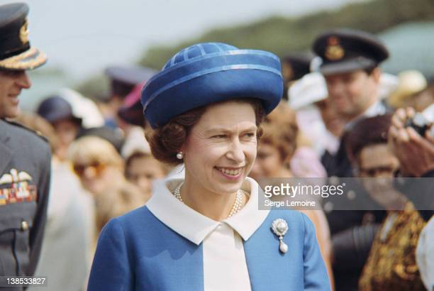 Queen Elizabeth II wearing a blue suit and hat during a visit to New Zealand circa 1977