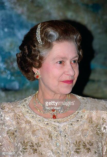 Queen Elizabeth II Wearing A Diamond Hairclip In Her Hair And A Diamond Necklace And Matching Earrings At The Pardo Palace During A Visit To Spain