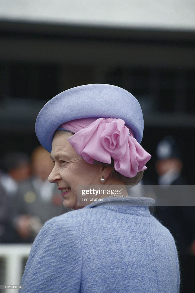 Queen Elizabeth II, wearing a hat by milliner Frederick Fox, at the Derby meeting, at Epsom racecourse in Epsom, Surrey, England, Great Britain, 5 June 1991.