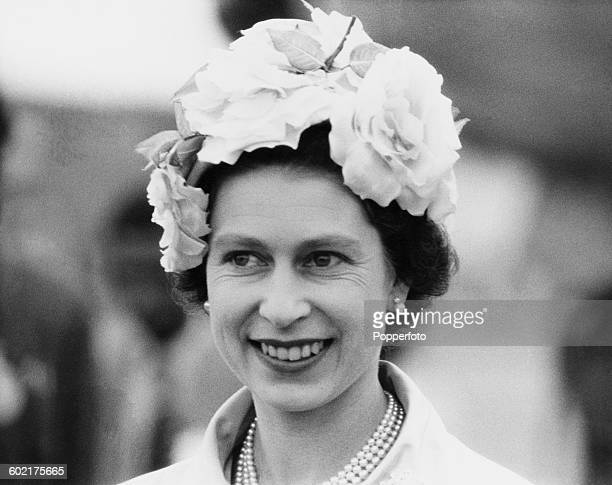 Queen Elizabeth II wearing a hat trimmed with roses on her arrival in Dacca during a Commonwealth visit to East Pakistan 16th February 1961