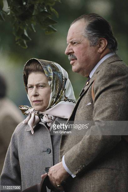 Queen Elizabeth II wearing a headscarf and Count Andraxy of Liechtenstein attending the Royal Windsor Horse Show held at Home Park in Windsor...