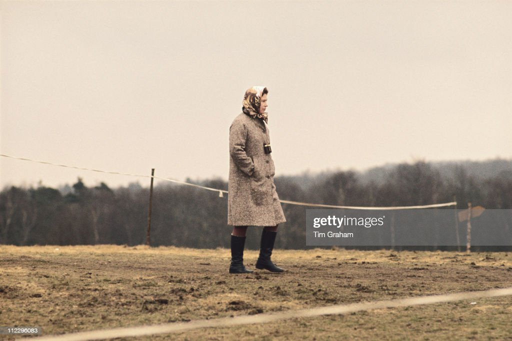 Queen Elizabeth II, wearing a headscarf and wellington boots, at the Crookham Horse Trials, in Crookham, Berkshire, England, Great Britain, circa 1975.