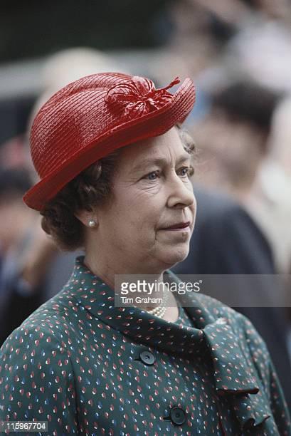Queen Elizabeth II wearing a red hat designed by miliner Frederick Fox attending the Sandringham Flower Show on the Sandringham estate Norfolk...