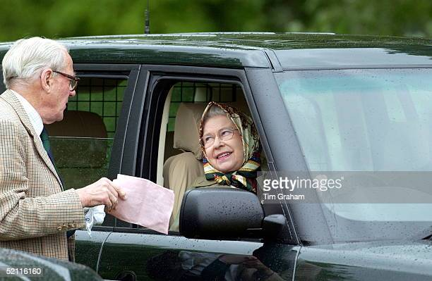 Queen Elizabeth II Wearing A Silk Headscarf And Driving A Range Rover 4wheel Drive Vehicle At The Royal Windsor Horse Show Sponsored By Land Rover...