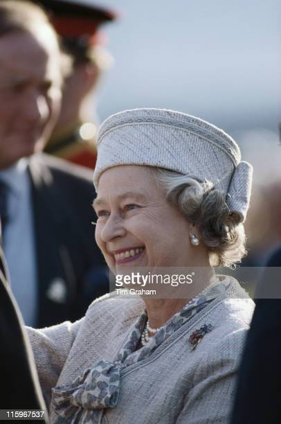 Queen Elizabeth II wearing a suit designed by fashion designer John Anderson smiling as she attends the Royal Windsor Horse Show held at Home Park in...