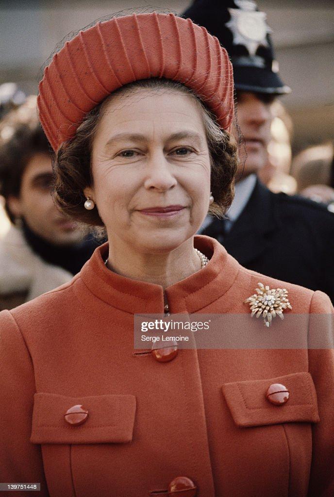 Queen Elizabeth II wearing an orange coat and hat, London, UK, circa 1977.