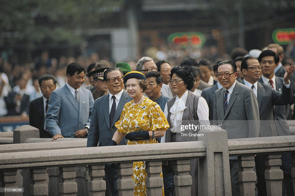 Queen Elizabeth II, wearing an outfit and hat designed by fashion designer Ian Thomas, on a walkabout in Shanghai, during an official State Visit to China, 15 October 1986.